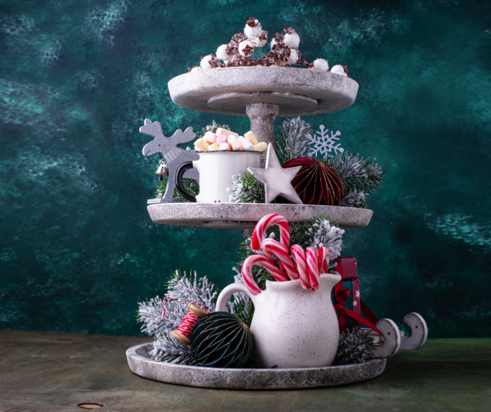Favorite Farmhouse Tiered Trays With A Christmas Theme including peppermints in a small vase
