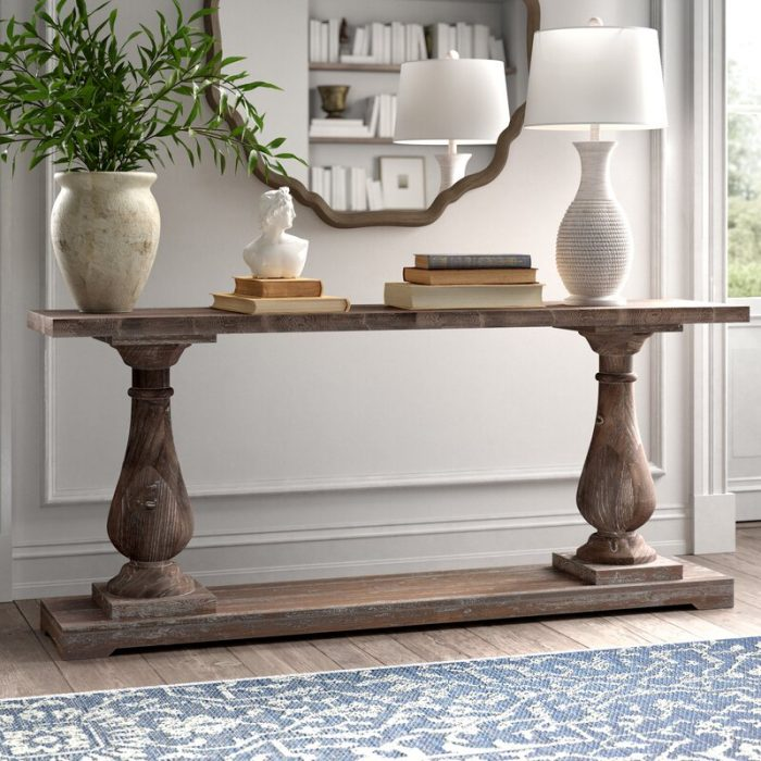 Console Table with a lamp and greenery