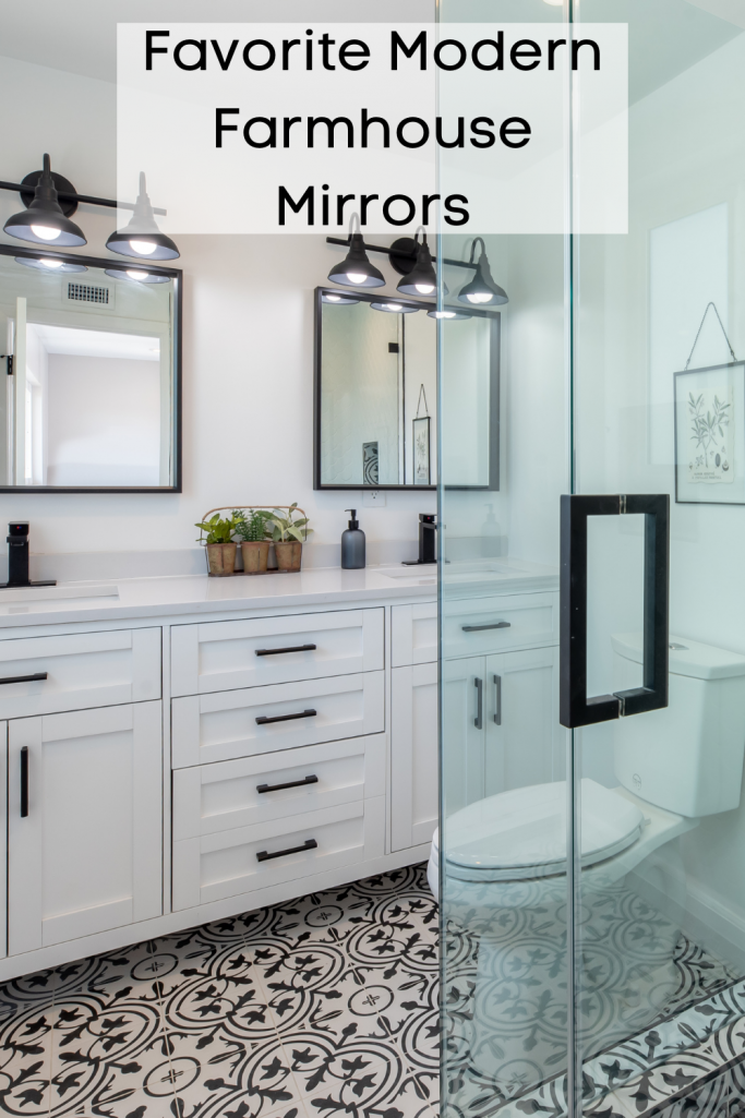 Bathroom with farmhouse mirrors and white cabinets