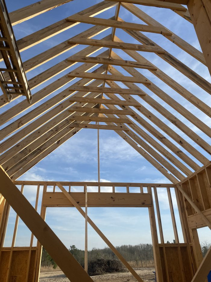 vaulted ceilings being built on new modern farmhouse