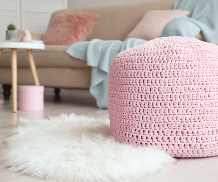 pink pouf in living room